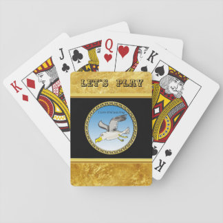 Cartoon seagull flying over head with a gold frame playing cards