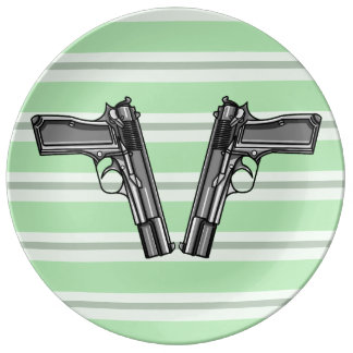 Cartoon style illustration of two handguns porcelain plates