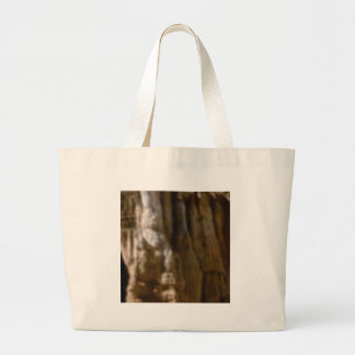 carved muscles in rock large tote bag
