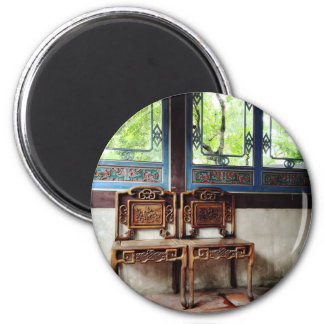 Carved patterns on wooden chairs and windows 6 cm round magnet