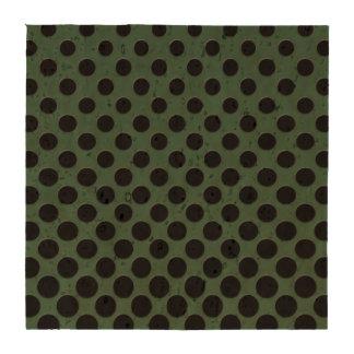 Cascading black polka dots on dark green coaster