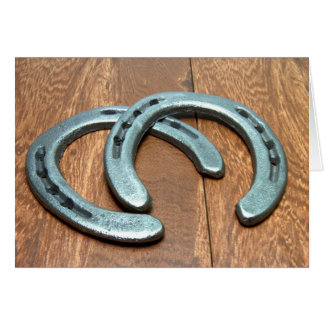 Cast iron horseshoes on barn wood card