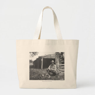 Cat eating out of a coffee can large tote bag