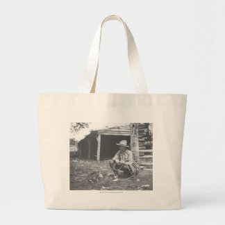 Cat eating out of a coffee can. large tote bag