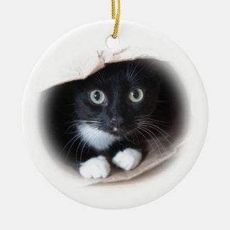 Cat in a bag round ceramic decoration