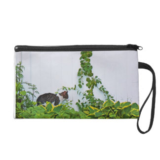 Cat in front of a white fence wristlet