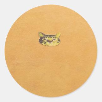 cat on a wall round sticker
