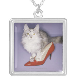 Cat stepping into high heel square pendant necklace