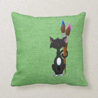 Cat With Paint Brushes On Green Cushion