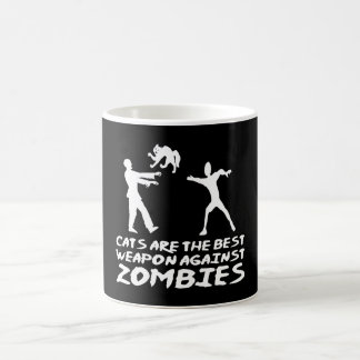 CATS ARE THE BEST WEAPON AGAINST ZOMBIES COFFEE MUG