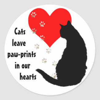 Cats leave paw-prints in our hearts round sticker