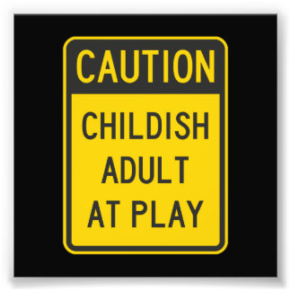 Caution Childish Adult at Play Photo