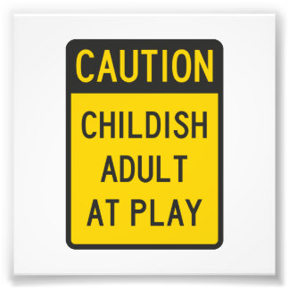 Caution Childish Adult at Play Photograph