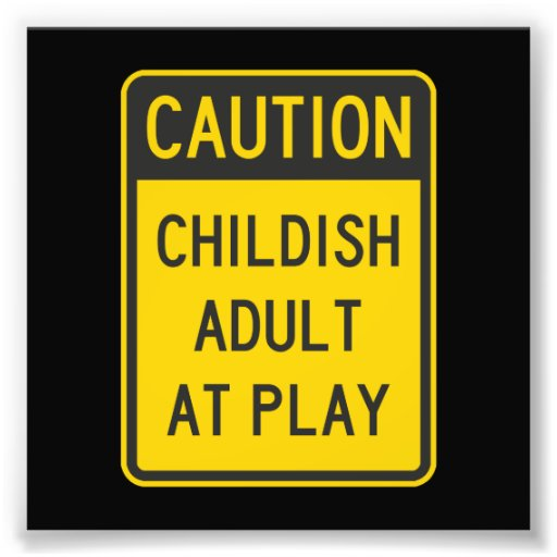 Caution Childish Adult at Play Photo