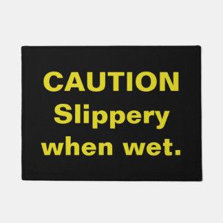 Caution. Slippery when wet. Doormat