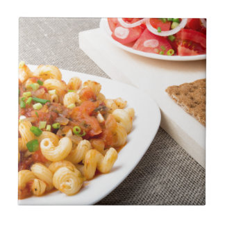 Cavatappi Pasta with sauce of stewed vegetables Small Square Tile