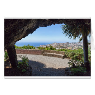 Cave outlook on sea and village on Madeira Card