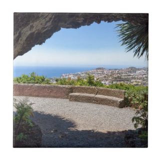 Cave outlook on sea and village on Madeira Ceramic Tile