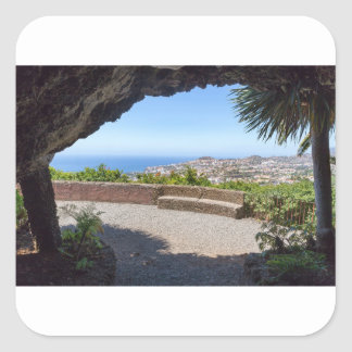 Cave outlook on sea and village on Madeira Square Sticker