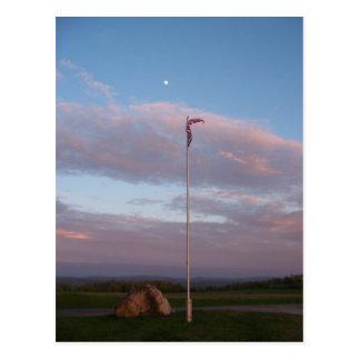 Cemetery flag at dusk postcard