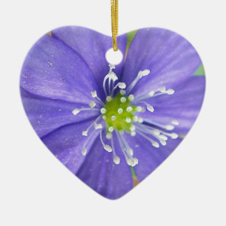 Center of a blue flower with white stamps ceramic heart decoration