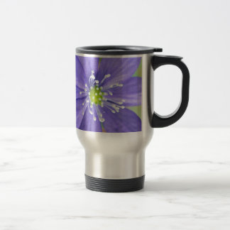Center of a blue flower with white stamps stainless steel travel mug