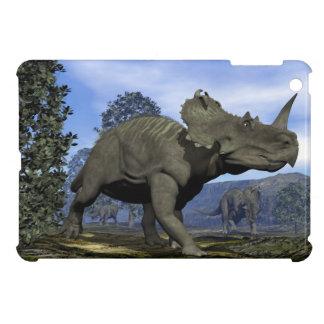 Centrosaurus dinosaurs walking among magnolia tree case for the iPad mini