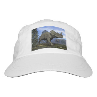 Centrosaurus dinosaurs walking among magnolia tree hat