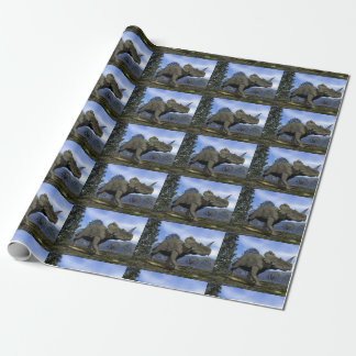 Centrosaurus dinosaurs walking among magnolia tree wrapping paper