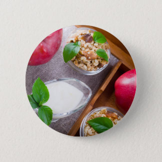 Cereal with walnuts and raisins, yogurt and apples 6 cm round badge