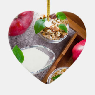 Cereal with walnuts and raisins, yogurt and apples ceramic heart decoration