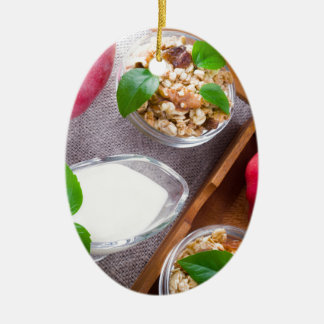 Cereal with walnuts and raisins, yogurt and apples ceramic oval decoration