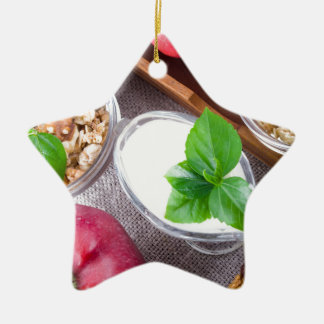Cereal with walnuts and raisins, yogurt and apples ceramic star decoration