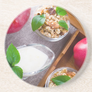 Cereal with walnuts and raisins, yogurt and apples coaster