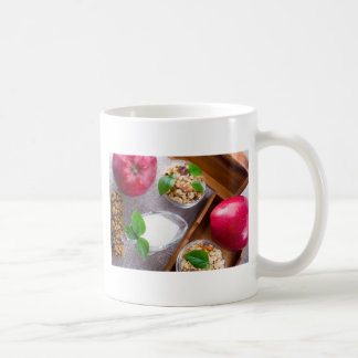 Cereal with walnuts and raisins, yogurt and apples coffee mug