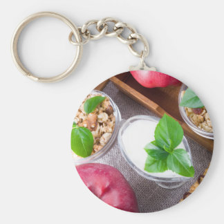 Cereal with walnuts and raisins, yogurt and apples key ring