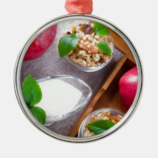 Cereal with walnuts and raisins, yogurt and apples metal ornament