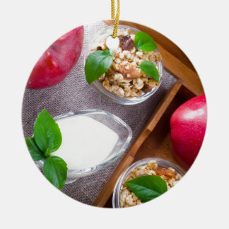 Cereal with walnuts and raisins, yogurt and apples round ceramic decoration