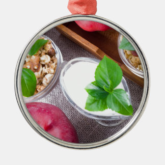 Cereal with walnuts and raisins, yogurt and apples Silver-Colored round decoration
