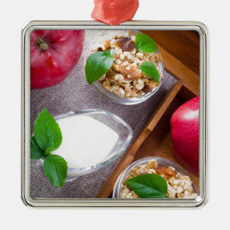 Cereal with walnuts and raisins, yogurt and apples Silver-Colored square decoration
