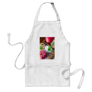 Cereal with walnuts and raisins, yogurt and apples standard apron