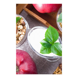 Cereal with walnuts and raisins, yogurt and apples stationery
