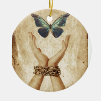 Chained Hand With Butterfly Hovering Above Ceramic Ornament
