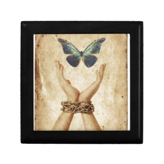 Chained Hand With Butterfly Hovering Above Gift Box