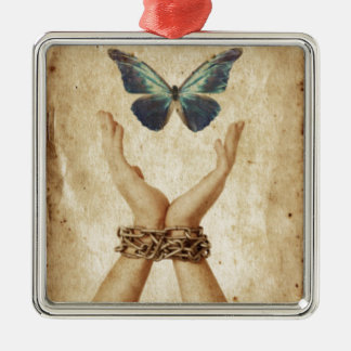 Chained Hand With Butterfly Hovering Above Metal Ornament