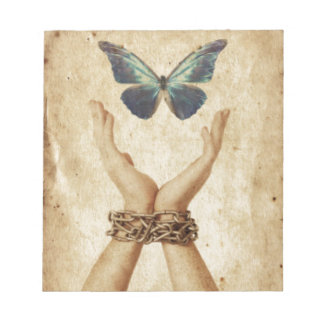 Chained Hand With Butterfly Hovering Above Notepad