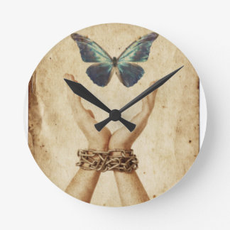 Chained Hand With Butterfly Hovering Above Round Clock