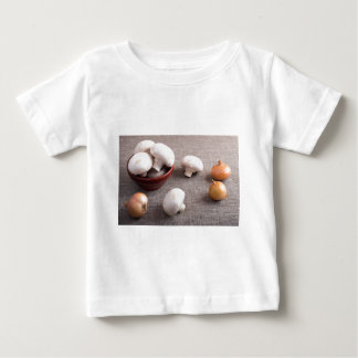 Champignon mushrooms and onions on the table baby T-Shirt