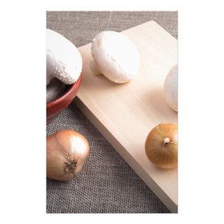 Champignon mushrooms and onions on the table stationery