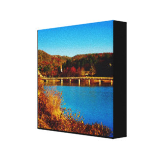 chapel behind lake in the fall canvas print